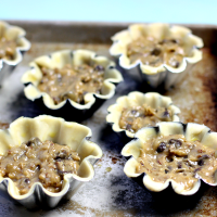 Making mini chocolate chip pies with fluted tart pans!