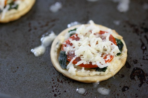 Adding grated cheese on top of these mini appetizers makes them delicious!