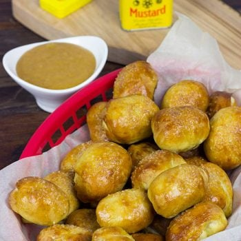 THESE ARE AMAZING! Perfect for gameday appetizers! Stuffed Pretzel Bites with Homemade Honey Mustard Dipping Sauce
