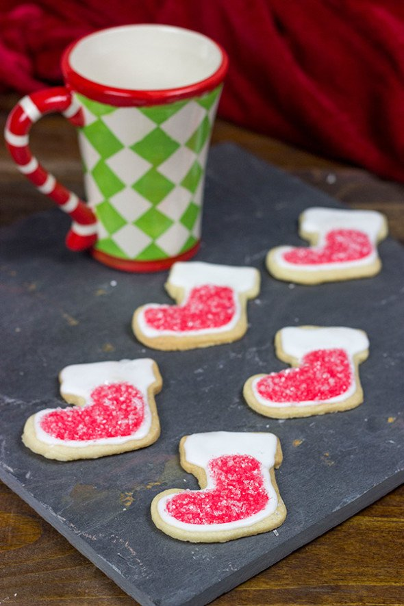 Classic Christmas Cookies: Thin butter cookie topped with icing and festive decorations