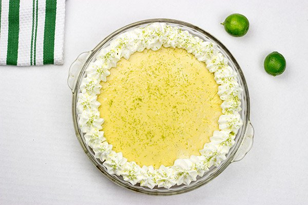 Classic Key Lime Pie: a tart key lime filling inside of a sweet graham cracker crust!