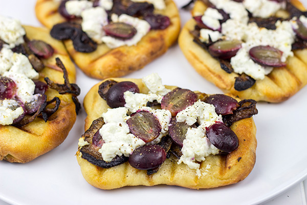Grilled Goat Cheese Flatbread with Caramelized Onions + Roasted Red Grapes