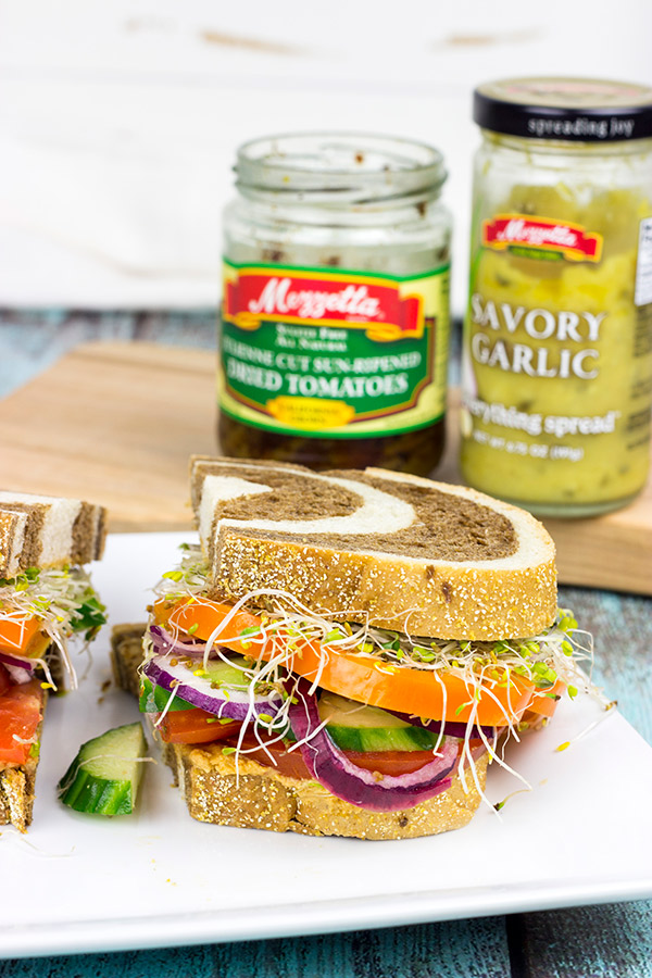 These Sun-Dried Tomato and Garlic Hummus Sandwiches are loaded with delicious, creamy hummus and fresh, crispy veggies. They're the perfect summer lunch!