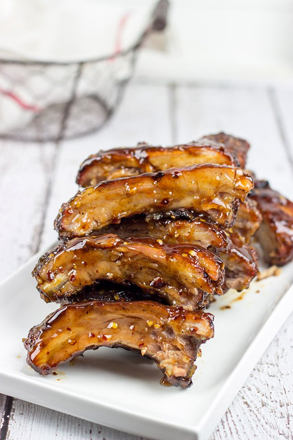 Nothing says summer like grilling ribs in your backyard. These Sweet Chili Glazed Baby Back Ribs offer a fun twist on an American classic!