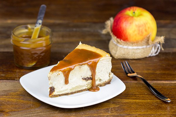 This Caramel Apple Cheesecake is loaded with apple flavor, and it's baked in a gingersnap crust. It's everything you love about the Fall...just in cheesecake form!