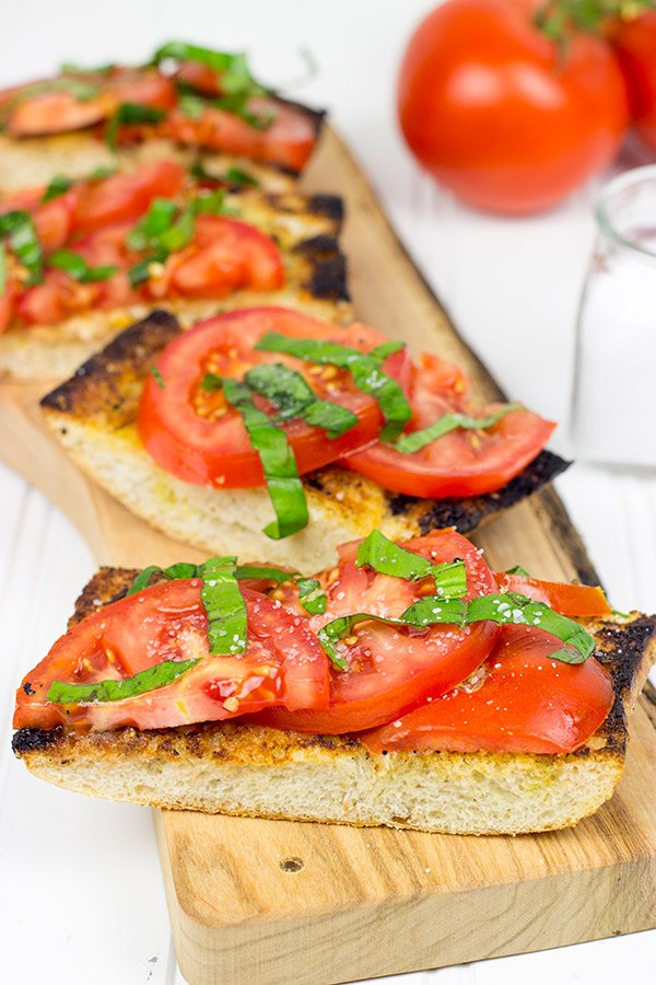 Instead of toasting bread, throw it on the grill! This Grilled Bruschetta makes for the perfect summer appetizer (or dinner)!