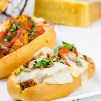 This Grilled Chicken Parm Sandwich is covered with pasta sauce and melted cheese to create a lighter version of a classic sandwich!