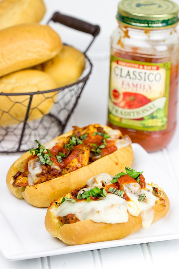 This Grilled Chicken Parm Sandwich is covered with pasta sauce and melted cheese to create a lighter version of a classic sandwich! #shop