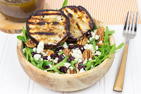 This Grilled Pear, Gorgonzola and Pecan Arugula Salad is surprisingly easy to make. Top it with a tasty, homemade Honey Balsamic Dressing for an extra boost of flavor!