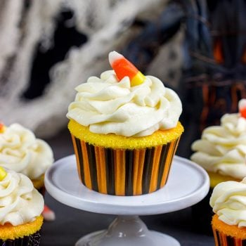 A bit of yellow and orange food coloring turns these classic vanilla cupcakes into Candy Corn Cupcakes. They're perfect for Halloween!