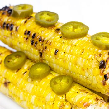This Spicy Maple Grilled Corn is brushed with a delicious hot sauce + maple syrup combo. It's the perfect side dish for the grill!