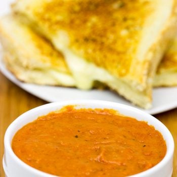 This Tomato Grilled Cheese Soup is what happens when tomato soup meets a grilled cheese sandwich. It's the ultimate comfort food, and it's guaranteed to warm you up on a cold winter day!