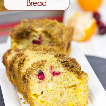 Loaded with cranberries and mandarin oranges and topped with a graham cracker crumble, this tasty Cranberry Mandarin Orange Bread is perfect for holiday baking!