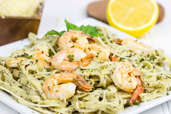 Pull out that pasta maker and make some homemade Basil Garlic Fettuccine. Top it with Lemon Garlic Shrimp for an easy date-night at home meal!