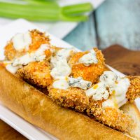 These delicious Buffalo Chicken Hoagies feature baked chicken coated in crispy breadcrumbs and tangy, homemade Buffalo sauce. They're the perfect sandwich for the big game!