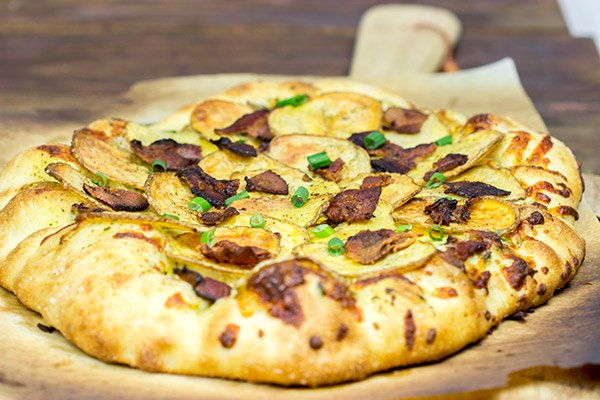 Looking for a delicious and unique pizza topping? Try some spuds! This Roasted Potato, Bacon and Onion Pizza is the perfect comfort food on a cold night!