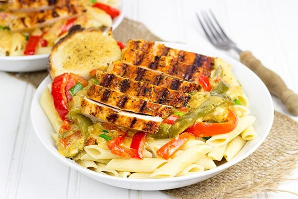Celebrate Mardi Gras with some delicious Cajun food! This Cajun Chicken Pasta is one of our favorites!