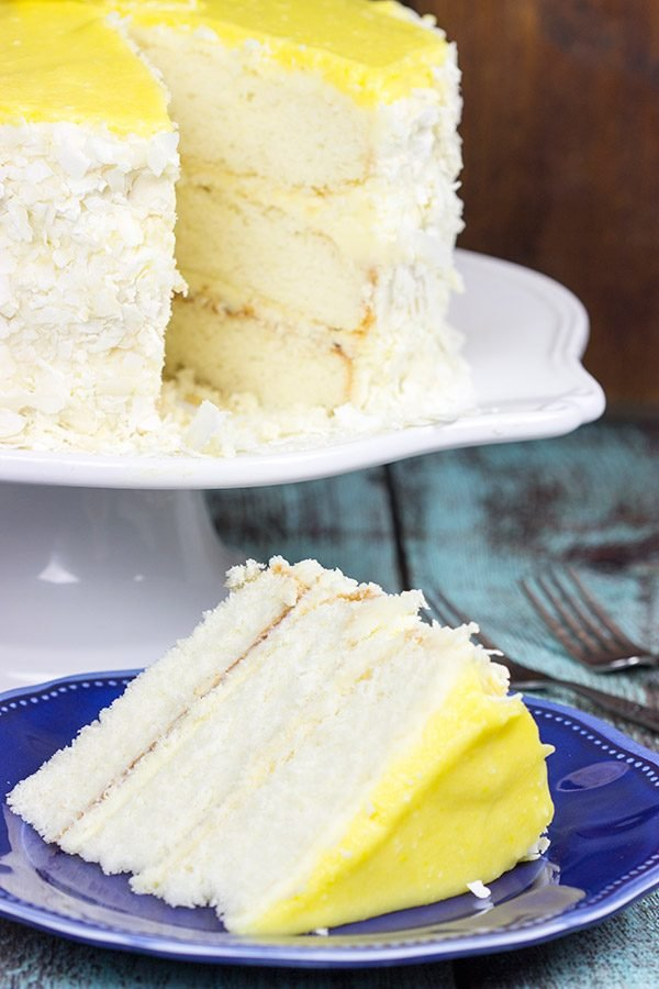 Decadent coconut flakes...sweet vanilla buttercream...tart lemon curd. One slice of this Lemon Coconut Cake will whisk you away to a warm Caribbean island!