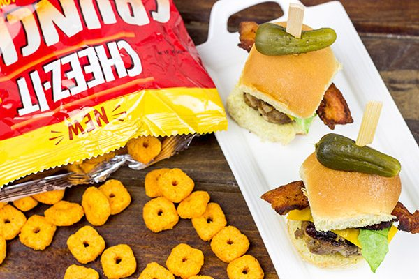 Stuffed with cheese and then topped with more cheese, these Triple Cheddar Bacon Sliders are the perfect snack to serve during the big game!