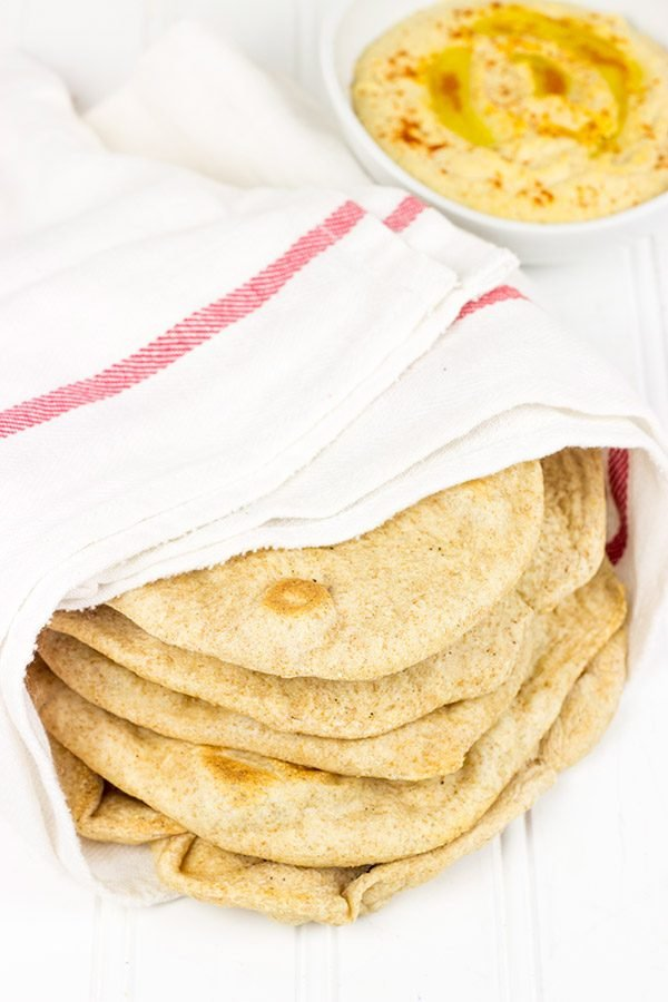 This Homemade Pita Bread is incredibly tasty! Serve with hummus for a light lunch or a fun afternoon snack.
