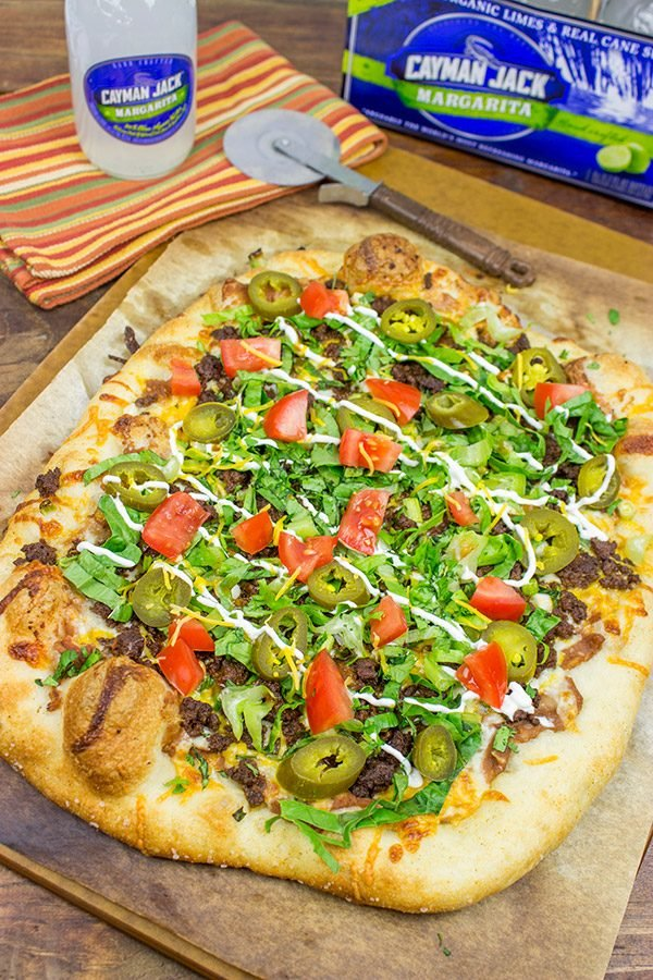 Topped with seasoned beef and your favorite taco ingredients, this Taco Pizza is a delicious way to celebrate the arrival of warm(er) weather!