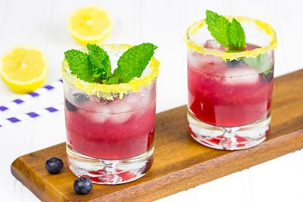 Garnished with lemon sugar, this Blueberry Bourbon Smash makes for one heck of an awesome summer cocktail!
