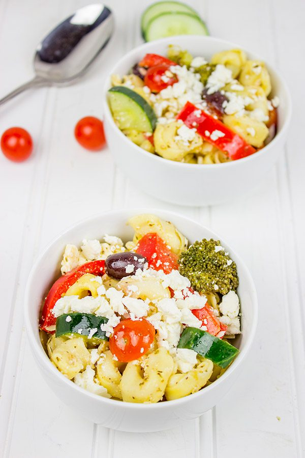 This Greek Tortellini Pasta Salad is loaded with all of your favorite Greek salad toppings...and it's perfect for summer picnics!