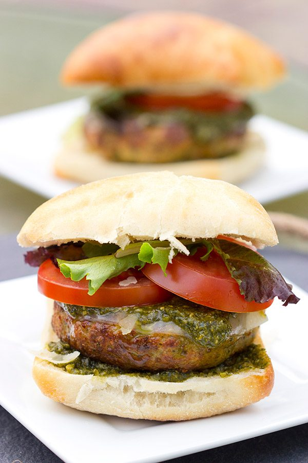 Looking for a unique recipe for the grill? Complete with pesto and Parmesan cheese, these Pesto Chicken Burgers are sure to be a hit this summer!
