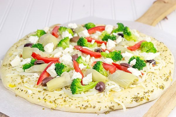 Topped with artichokes, olives and feta, this Greek Pizza is perfect for weekend pizza night!