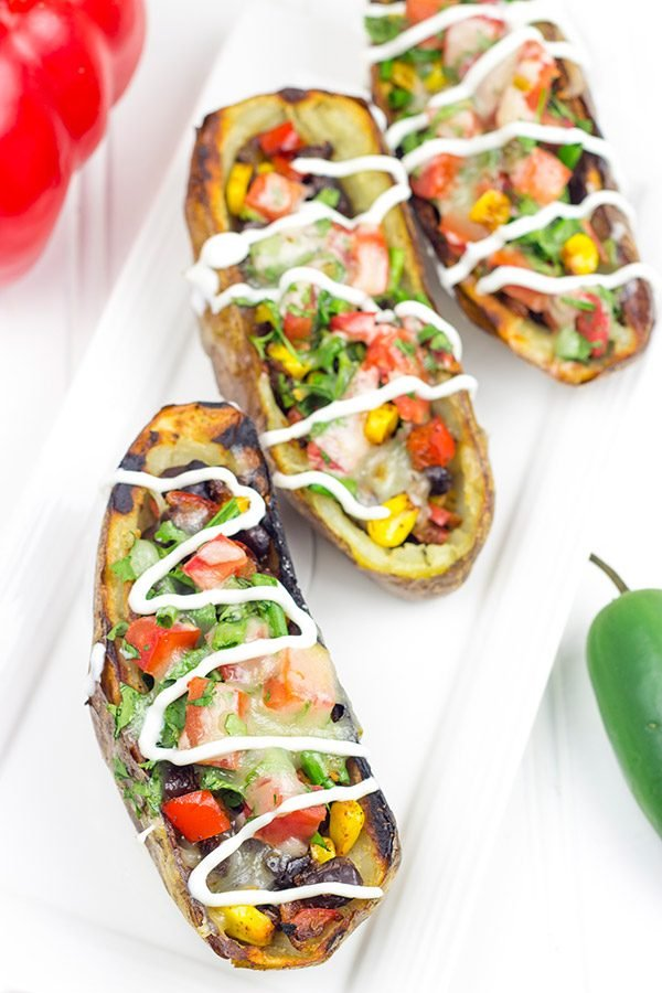 Loaded with layers of flavor, these Grilled Southwestern Potato Skins are one heck of a delicious summer appetizer!