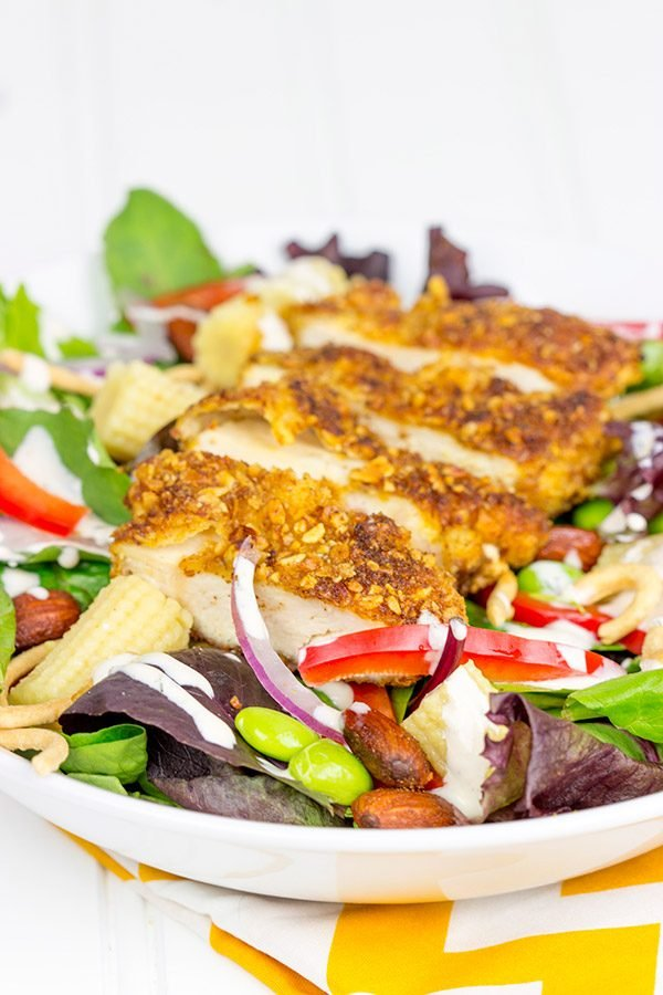 Topped with sriracha almond-encrusted chicken and a sriracha ranch dressing, this Sriracha Almond Chicken Salad makes for a tasty summer lunch!