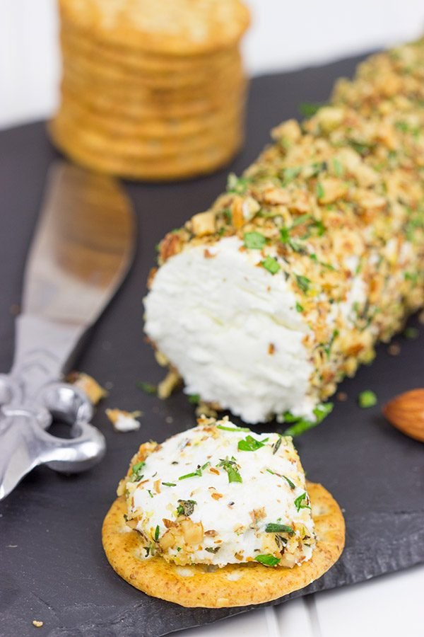 Rolled in chopped almonds and fresh herbs, this Almond Herb Goat Cheese makes for a quick and tasty summer snack!