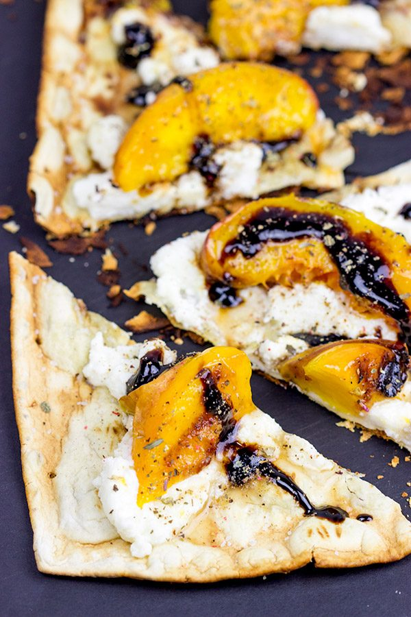 Grab some fresh peaches and toss 'em on the grill! This Grilled Peach and Ricotta Flatbread makes for one awesome summer meal!
