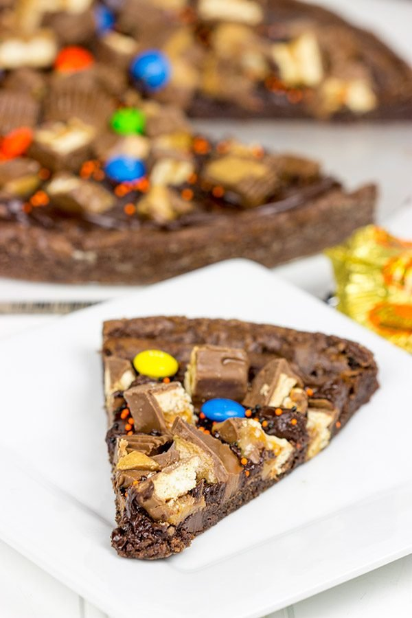 This Brownie Pizza is a fun way to use some of that extra Halloween candy this year!