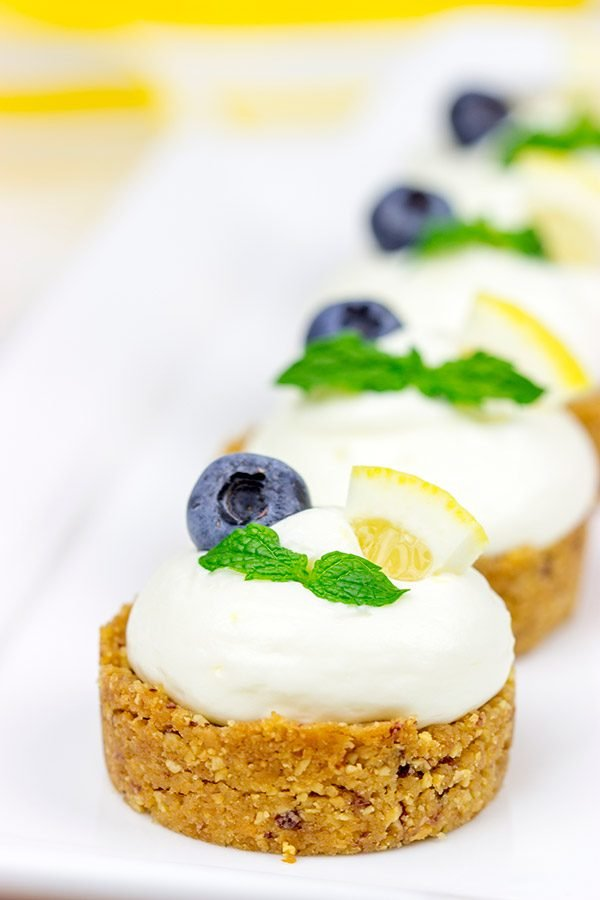 Featuring a blueberry almond crust topped with a light lemon cream, these Lemon Blueberry Almond Bites make for a great summer dessert!