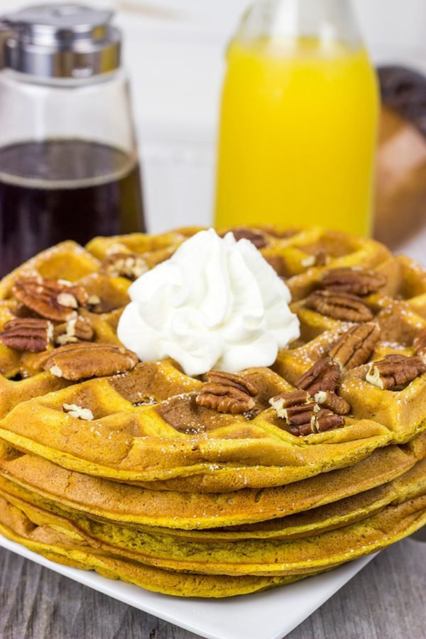 These Pecan Pumpkin Waffles are packed with tasty autumn spices...and they're perfect for Sunday morning breakfast!