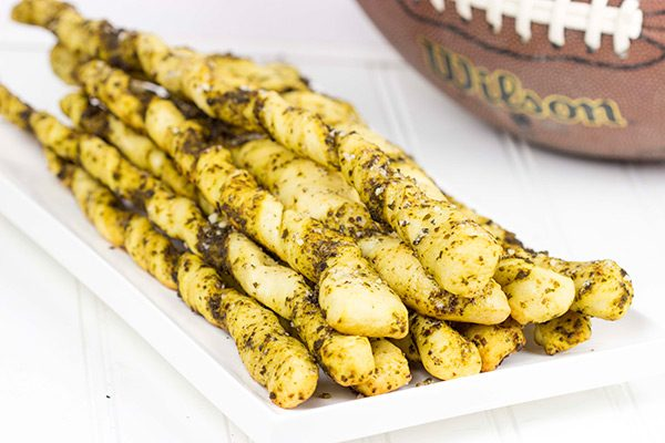 These Garlic Pesto Breadsticks are a fun and tasty snack...perfect for football games on cold winter weekends!