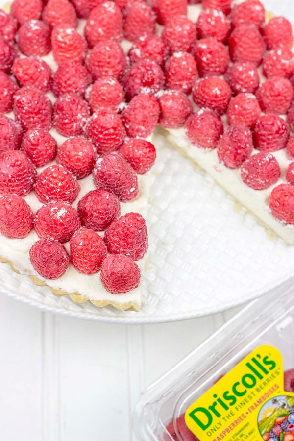 Featuring a light, lemony base and topped with fresh raspberries, this Lemon Raspberry Mascarpone Tartis bound to be a new holiday favorite in your house!