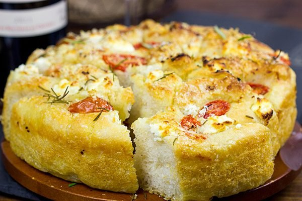 Celebrate the holidays with a batch of this tasty Goat Cheese and Tomato Focaccia!