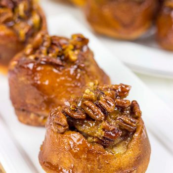 Topped with a delicious gooey honey pecan mixture, these Honey Pecan Sticky Buns will magically disappear from your kitchen!