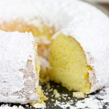 This Powdered Sugar Doughnut Cake is a throwback to Saturday morning cartoons and powdered sugar doughnuts!