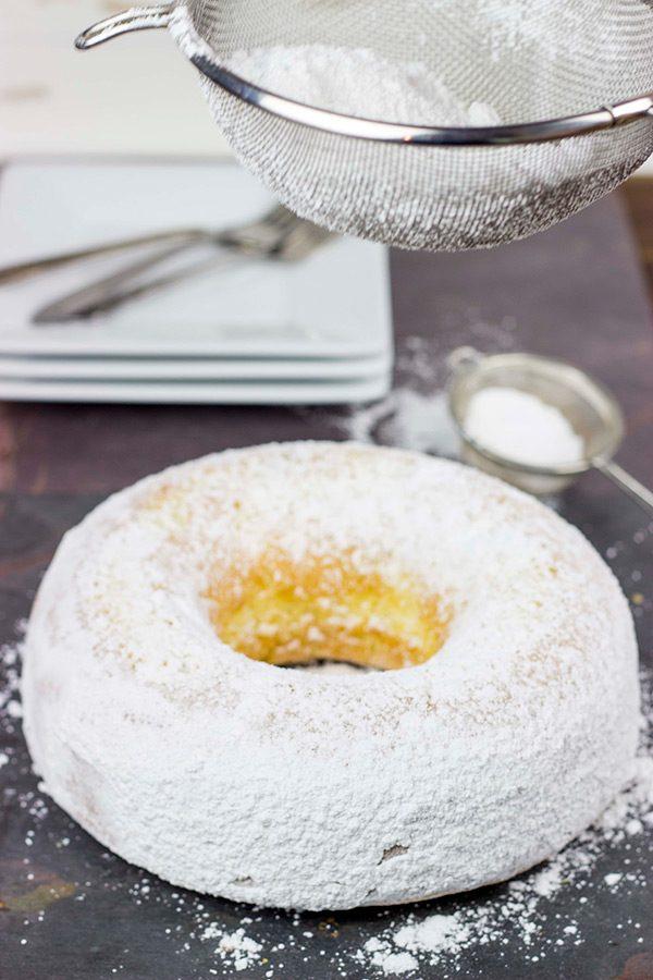 This Powdered Sugar Doughnut Cake is a throwback to Saturday morning cartoons and powdered sugar doughnuts!