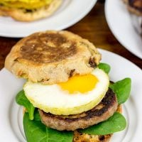 Making breakfast for a crowd? Kitchen hack: Bake eggs in muffin tins to save time! These Sausage and Egg Muffin Sandwiches are a favorite around our house!