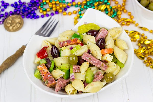 Grab some beads and celebrate Mardi Gras with this tasty Muffaletta Pasta Salad!