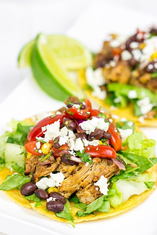 These Pulled Pork Tostadas are a quick and easy way to break out of the boring dinner routine!