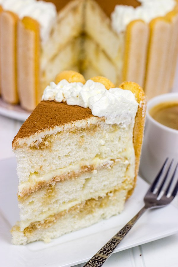 Featuring layers of white cake brushed with coffee and a hint of rum, this Tiramisu Cake is a new favorite in our house!