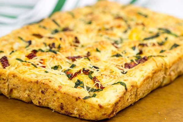 Need a unique and tasty appetizer? Give this Cheesy Spinach and Sundried Tomato Focaccia a try! (Just don't eat it all before the party...)