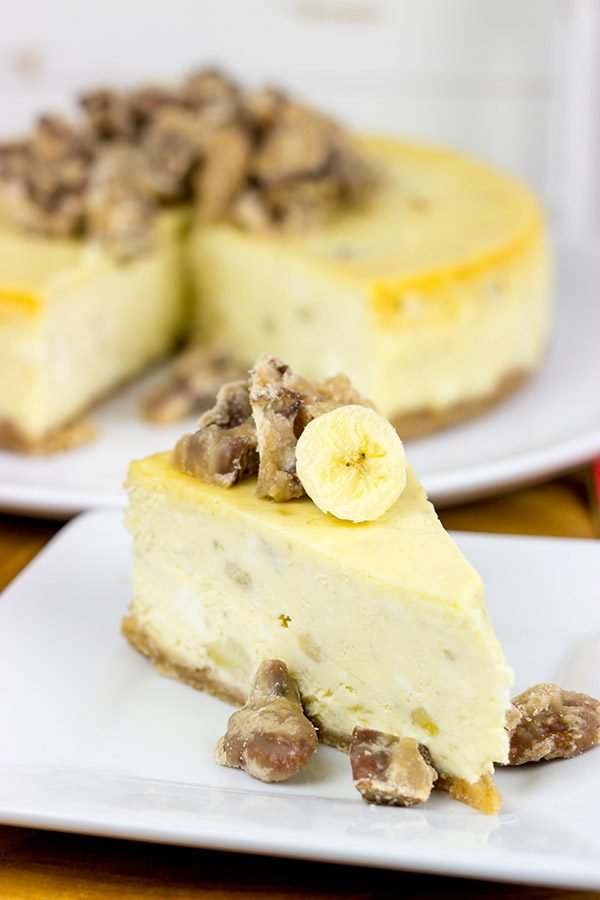A cross between banana pudding and cheesecake, this Banana Cheesecake with Crumbled Pralines is the perfect summertime dessert!
