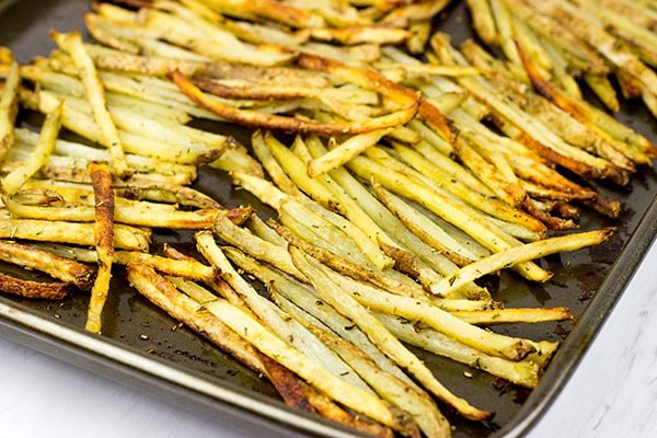 Thin-cut fries seasoned with fresh rosemary and garlic, these Rosemary Garlic Smashfries will become a favorite in your house!