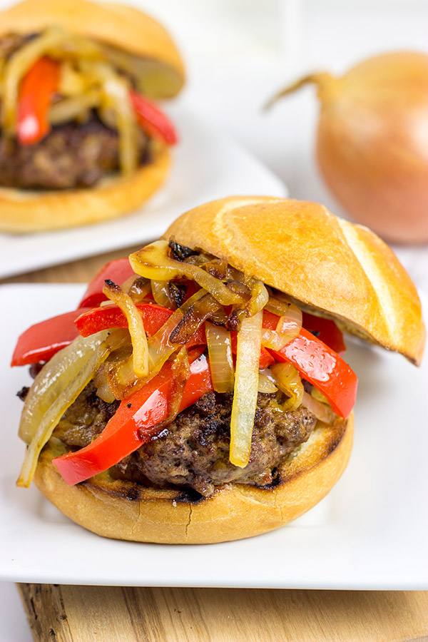 Break out the grill and serve up this Smoky Pepper and Onion Cheeseburger for dinner tonight!